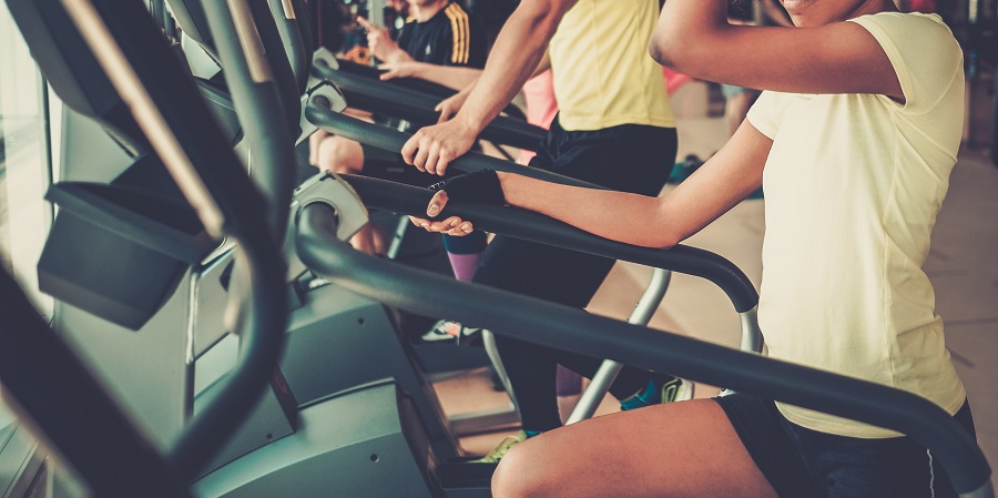 People exercising on a cardio training machines in a home gym
