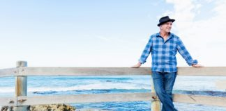 man standing by ocean thinking about multivitamin for men over 50 years old