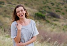 woman laughing thinking about multivitamin for women over 40 years old