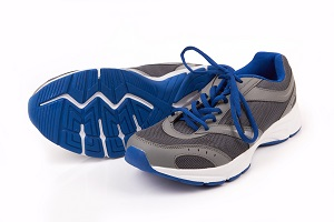 pair of treadmill running shoes over a white background