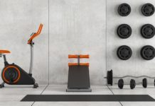 photo of a home gym with some pieces of fitness equipment